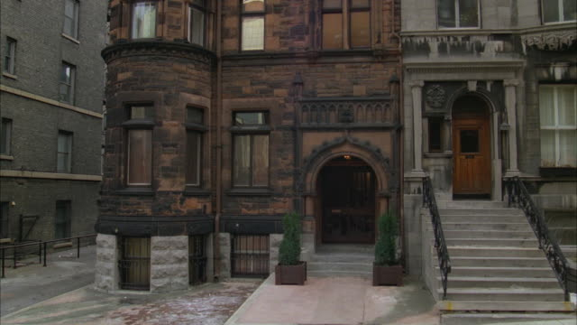 1980s WS CS Older three story brownstone apartment building