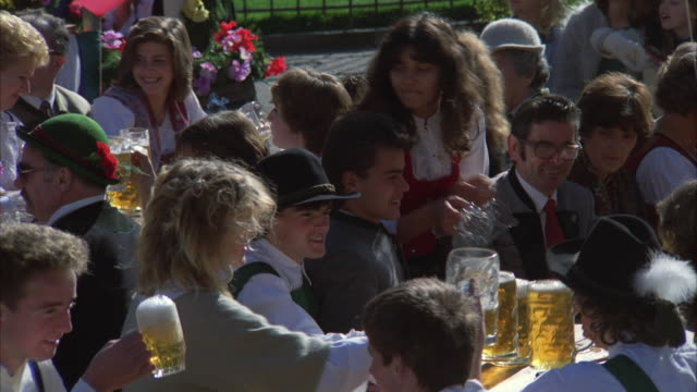 1980s MS People in beer garden drinking, eating and laughing