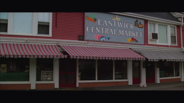 1980s ws store with sign reading eastwick central market - store sign stock videos & royalty-free footage