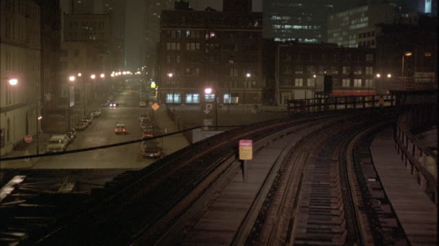 1980s ws pov view from elevated train reaching station at night - elevated train stock videos & royalty-free footage