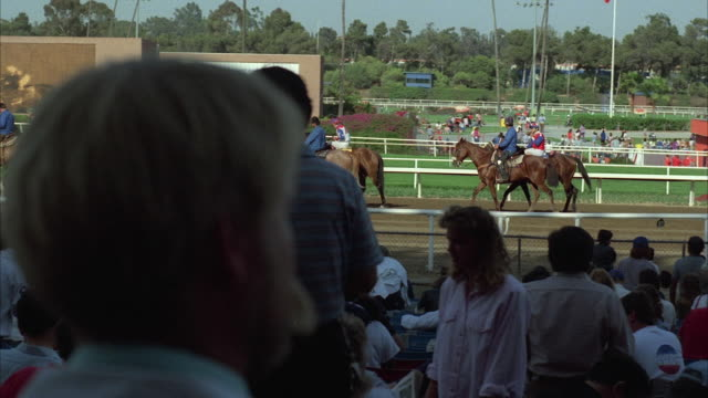 1980s WS PAN View from grandstands at horse race track to post parade