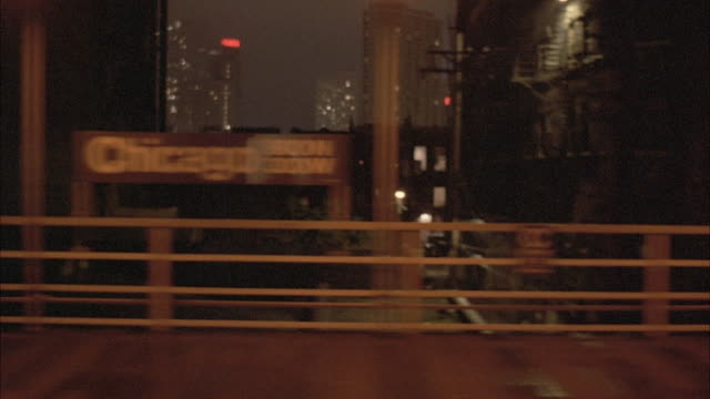 1980s ws pov view of skyline from elevated train at night - 1982 stock videos and b-roll footage