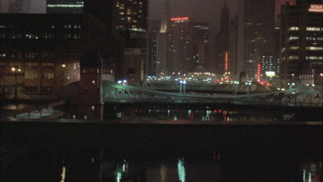 1980s ws pov view of skyline from elevated train at night - elevated train stock videos & royalty-free footage