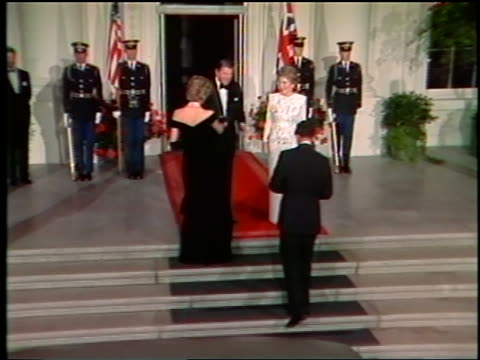 1980s zoom in princess diana + prince charles exit limousine + greet + pose with ronald + nancy reagan - 1985 stock-videos und b-roll-filmmaterial