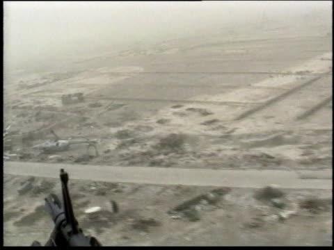 1990s aerial view of the landscape from the vantage point of a machine gunner / iraq - operation desert storm bildbanksvideor och videomaterial från bakom kulisserna