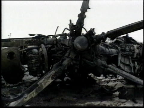 1990s burned remains of a propeller plane / iraq - 死傷者点の映像素材/bロール