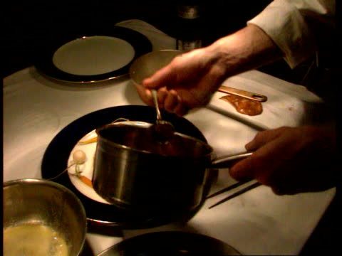 1990s cu chef putting vegetables and sauce onto plate with pigeon meat/ cu alex floyd head chef at leith's restaurant/ london england/ audio - eating utensil stock videos and b-roll footage