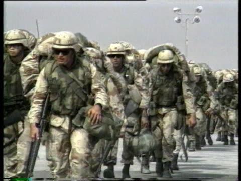 1990s montage us army troops walking across flightline toward airplane and boarding - ペルシャ湾点の映像素材/bロール