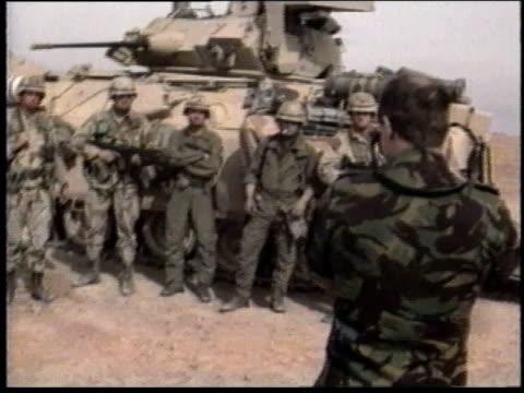 1990s ws soldiers pose for photo in front of tank / iraq - operation desert storm bildbanksvideor och videomaterial från bakom kulisserna