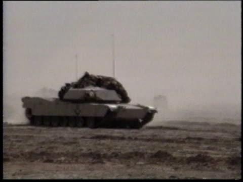 1990s ws tank driving across desert terrain / iraq - operation desert storm bildbanksvideor och videomaterial från bakom kulisserna