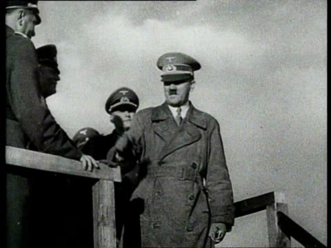19aug1939 b/w montage germans have built a defense line made of concrete fortifications bunkers and other reinforcements adolf hitler inspects the... - 防空壕点の映像素材/bロール