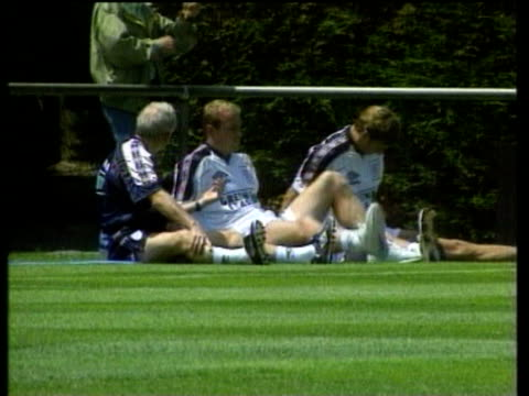 jun-1998 montage england team trains; glenn hoddle press conference on red cards / united kingdom / audio - one mid adult man only stock videos & royalty-free footage