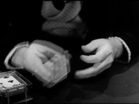 19th century gambler hands: male hands in ruffled shirt cuffs above poker table flipping playing card deck w/ fingers, pull back reveals male torso... - torso bildbanksvideor och videomaterial från bakom kulisserna