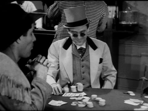 19th CENTURY GAMBLERS Middleaged male making remarks about man in sunglasses winning 'Frontiersman' spitting from table to bar again slide whistle...