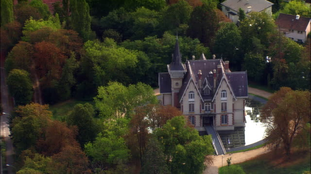 aerial 19th century house with circular moat/ paris, france - victorian stock videos & royalty-free footage