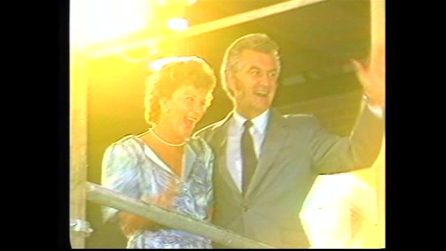 stockvideo's en b-roll-footage met 1am election night cu hazel hawke bob and i will be on a new adventure / bob and hazel hawke at desk with tally board in background / cutaway channel... - 1983
