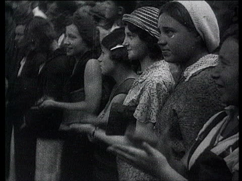 aug-1934 b/w montage soviet writers' first congress. arrival of maksim gorky. young women clapping. in congress hall. maksim gorky sitting at... - 1934 stock-videos und b-roll-filmmaterial