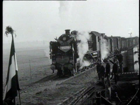 1dec1945 b/w montage opening of the new railway bridge across the maas first coal train rides over the bridge into the netherlands / netherlands - railway bridge stock videos & royalty-free footage