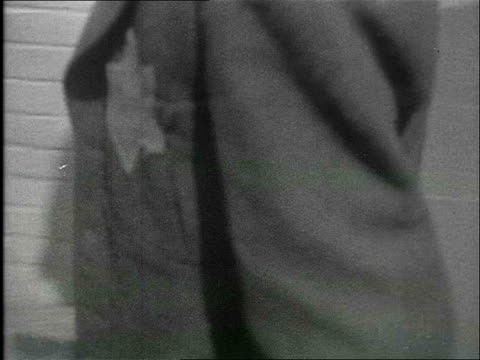 jan-1940 b/w montage street scenes of the jewish quarter in amsterdam, residents wear the star of david on their coats, woman pushing baby carriage /... - netherlands stock videos & royalty-free footage