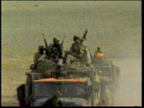 1Jan1991 MONTAGE Persian Gulf War Desert Storm US convoy in desert Hummers soldiers w/ heavy artillery full battle gear soldiers walking on road /...