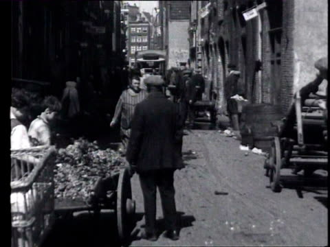 1may1927 b/w montage poor children and other inhabitants on the street and in alleyways / amsterdam noordholland netherlands - 1927 bildbanksvideor och videomaterial från bakom kulisserna