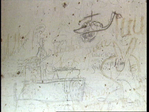 1oct1998 montage graffiti drawings on wall full of bullet holes depicting militia firing guns and helicopter crashing / mogadishu benadir somalia - scribble stock videos & royalty-free footage