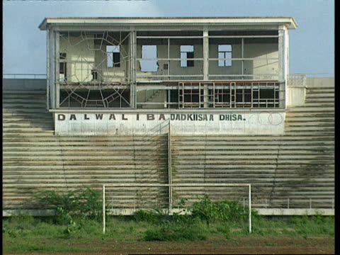 1oct1998 ws old broadcasters box inside mogadiscio stadium / mogadishu benadir somalia - western script stock videos & royalty-free footage
