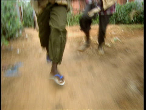 oct-1998 torsos and feet of two armed militiamen running with machine guns / mogadishu, benadir, somalia - alley stock videos & royalty-free footage