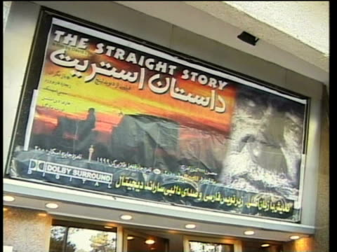 1st april 2000 ms la billboard hanging above entrance to movie theater / tehran, iran - tehran stock videos and b-roll footage