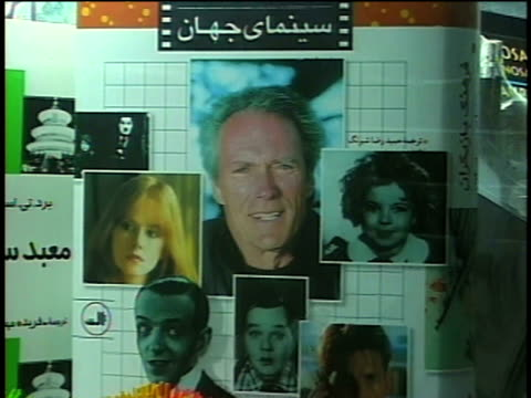1st april 2000 cu zo ms book cover with clint eastwood on shelf in bookstore / tehran, iran - fame stock videos and b-roll footage