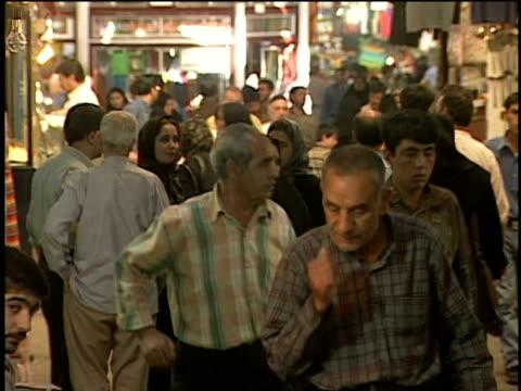 1st april 2000 ms r/f crowd walking in alley of bazaar / tehran, iran - teheran stock-videos und b-roll-filmmaterial