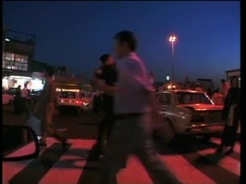 1st april 2000 ws pov crowd walking in tajrish square at night / tehran, iran - tehran stock videos & royalty-free footage