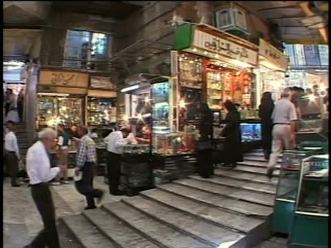 vídeos de stock e filmes b-roll de 1st april 2000 ws pan crowded bazaar with jewelry stalls / tehran, iran - cristaleira