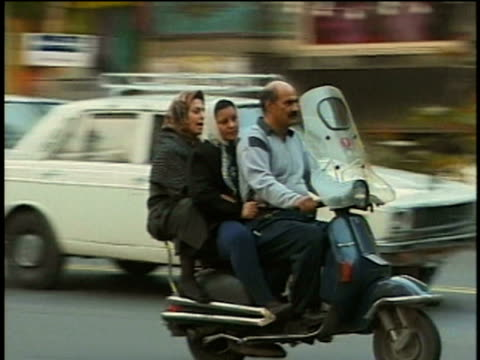 1st April 2000 MS PAN Family riding moped on crowded street / Tehran, Iran