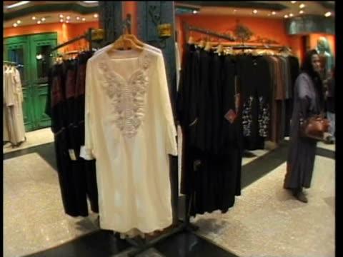 vidéos et rushes de 1st april 2000 ws pov inside high class clothing store in uptown boutique / tehran, iran - vêtement religieux