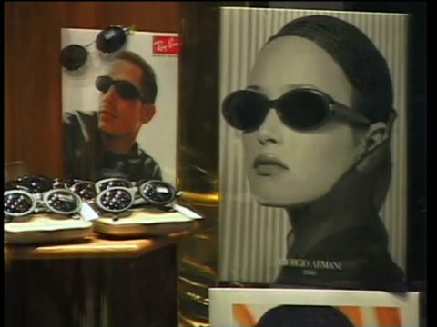 1st April 2000 CU ZO WS Posters and sunglasses on window display / Tehran, Iran