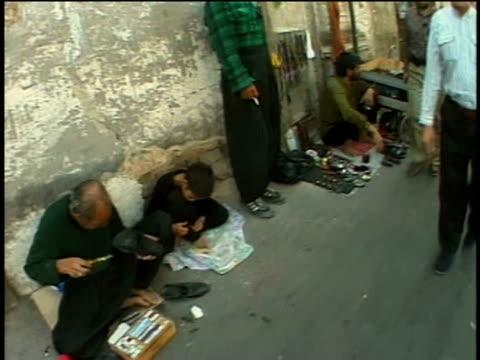 1st april 2000 ws pov street vendors sitting on sidewalk / tehran, iran - iran stock videos & royalty-free footage