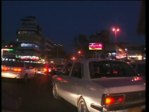 1st april 2000 ws pov traffic at tajrish square at night / tehran, iran - tehran stock videos and b-roll footage