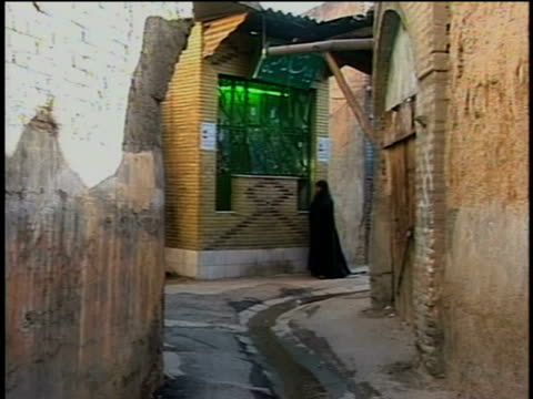 1st April 2000 WS Woman in hijab walking in alley / Tehran, Iran