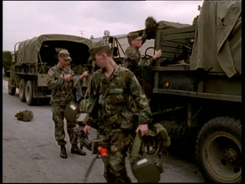 1st battalion 506th infantry of the 3rd brigade american troops stationed in korea checking kit and loading trucks - infantry stock videos and b-roll footage