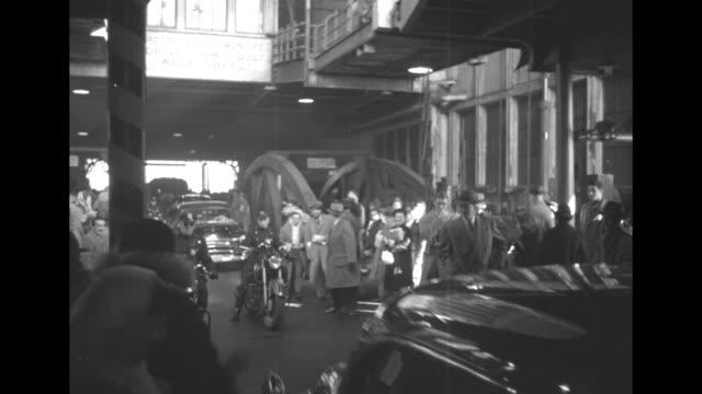 "vídeos de stock e filmes b-roll de 1st car in motorcade on ferry and surrounded by crowd, sign above car says ""help save human life, drive carefully, walk safely"" / car pulls forward,... - estátua da liberdade"