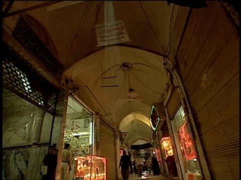1st feb 2000 ws la rear pov long bazaar corridor with sunlight falling in through ceiling / kashan, iran - skåp med glasdörrar bildbanksvideor och videomaterial från bakom kulisserna