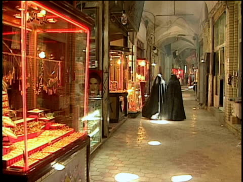 1st feb 2000 ws women in hijabs walking down alley of grand bazaar / kashan, iran - hijab stock videos and b-roll footage