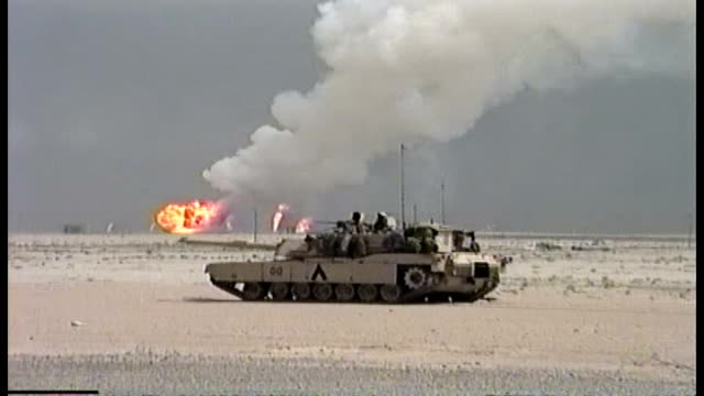 1st infantry division prepares to move into iraq, oil well fires in background. - イラク点の映像素材/bロール