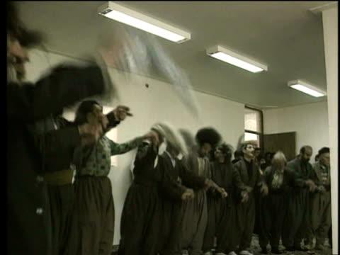 stockvideo's en b-roll-footage met 1st jun 2000 ms pan dervish men in ecstasy during dance of sema / village of najar, kurdistan, iran - op een rij