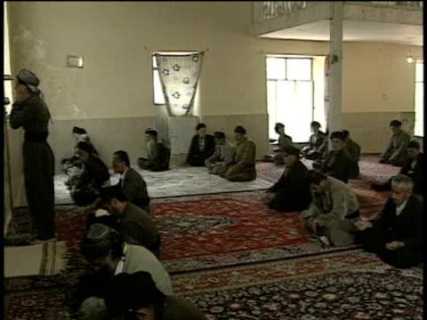 1st jun 2000 ws pan dervishes preparing for prayer in sufi center / village of najar, kurdistan, iran - スーフィズム点の映像素材/bロール