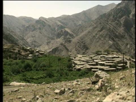 1st jun 2000 ws pov landscape with village nestled in mountains / village of najar, kurdistan, iran - iran stock videos and b-roll footage