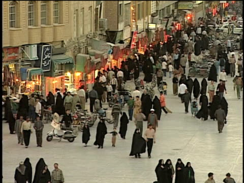 1st may 2000 ws ha pan crowded sidewalk / qum, iran - iran stock videos and b-roll footage