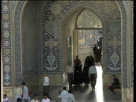 1st may 2000 ws ha people entering courtyard of saint massoumeh shrine / qum, iran - pellegrino video stock e b–roll