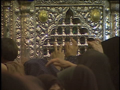 1st may 2000 cu zo ws women and kids touching and kissing altar in saint massoumeh shrine / qum, iran - pellegrino video stock e b–roll